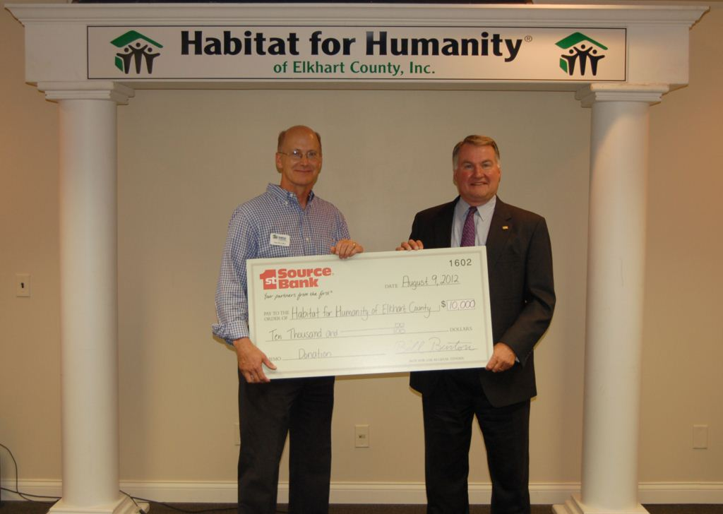 Bill Burton (r) presents donation to Tom McArthur of Habitat for Humanity of Elkhart County -746.jpg