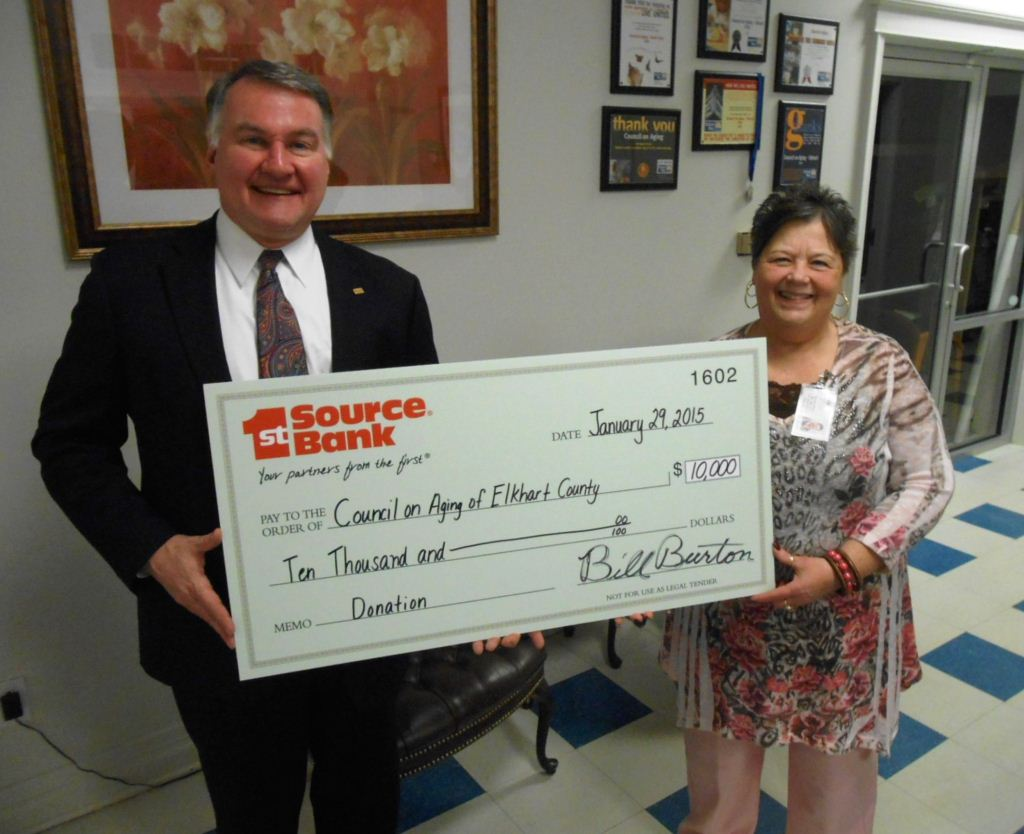 Bill Burton presenting donation to Bonnie Waltz at Council on Aging