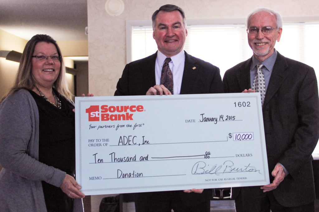 Bill Burton presenting donation to Donna Belusar and Cary Kelsey of ADEC