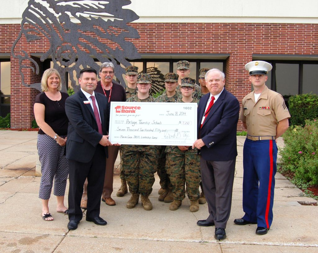 Bob Ax and Jesus Cervera presenting donation to Portage High School JROTC