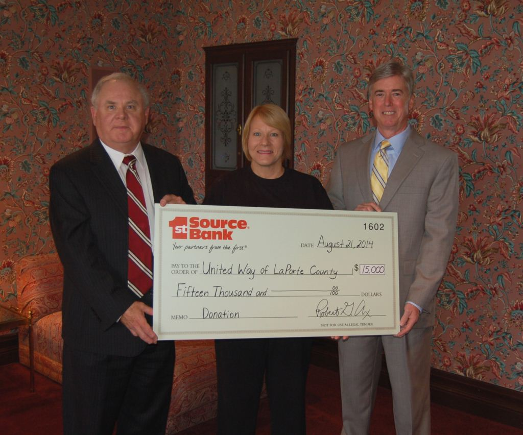 Bob Ax and Mike Arnett presenting a donation to Kris Pate of the United Way of LaPorte County