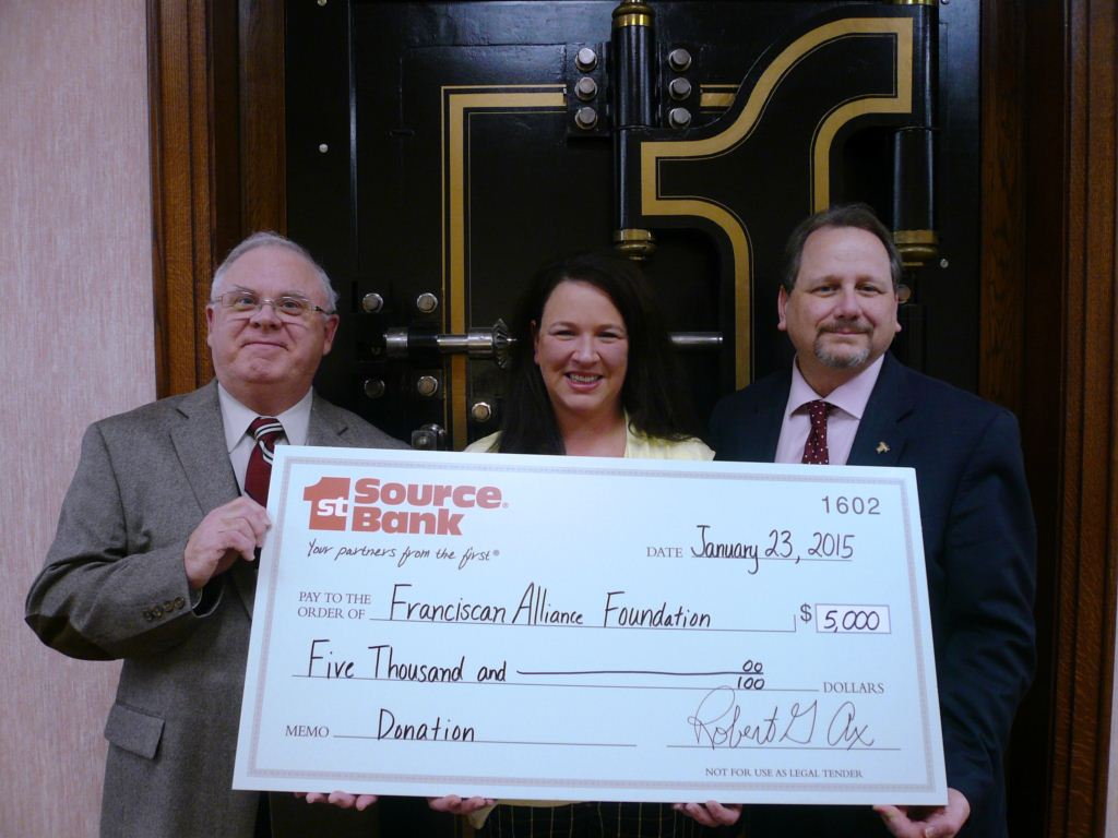 Bob Ax presenting donation to Tony Englert of Franciscan Alliance Foundation and Jennifer Homan of St. Anthony Health