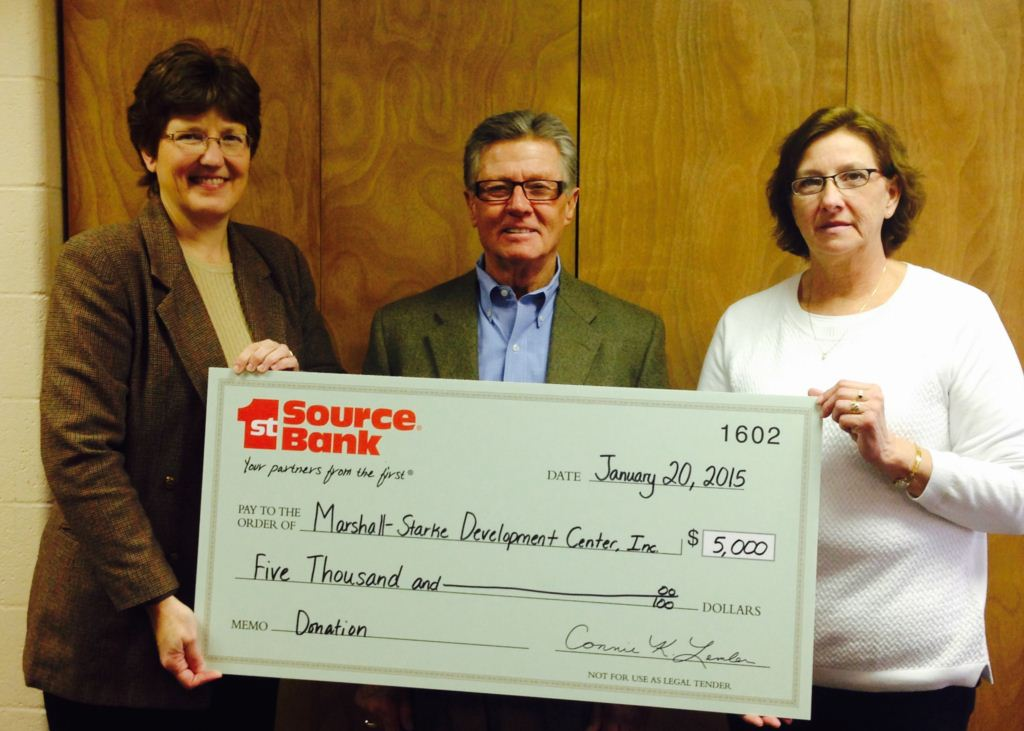 Connie Lemler presenting donation to Mike Lintner and Jodie Smith of Marshall-Starke Development Center