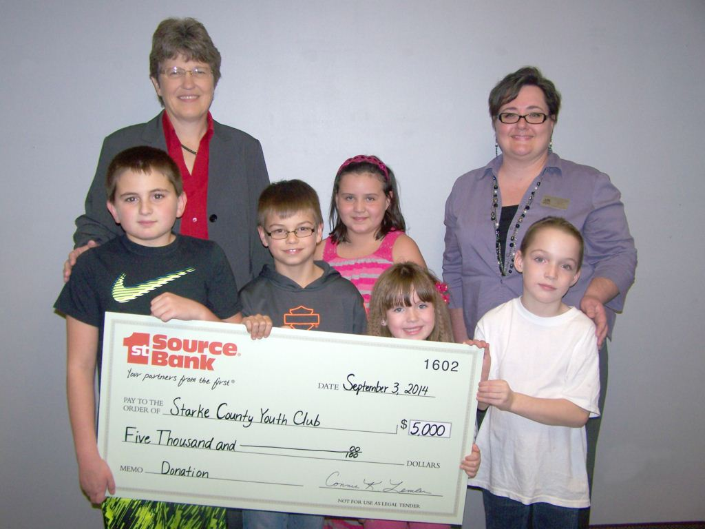 Connie Lemler presenting donation to Starke County Youth Club