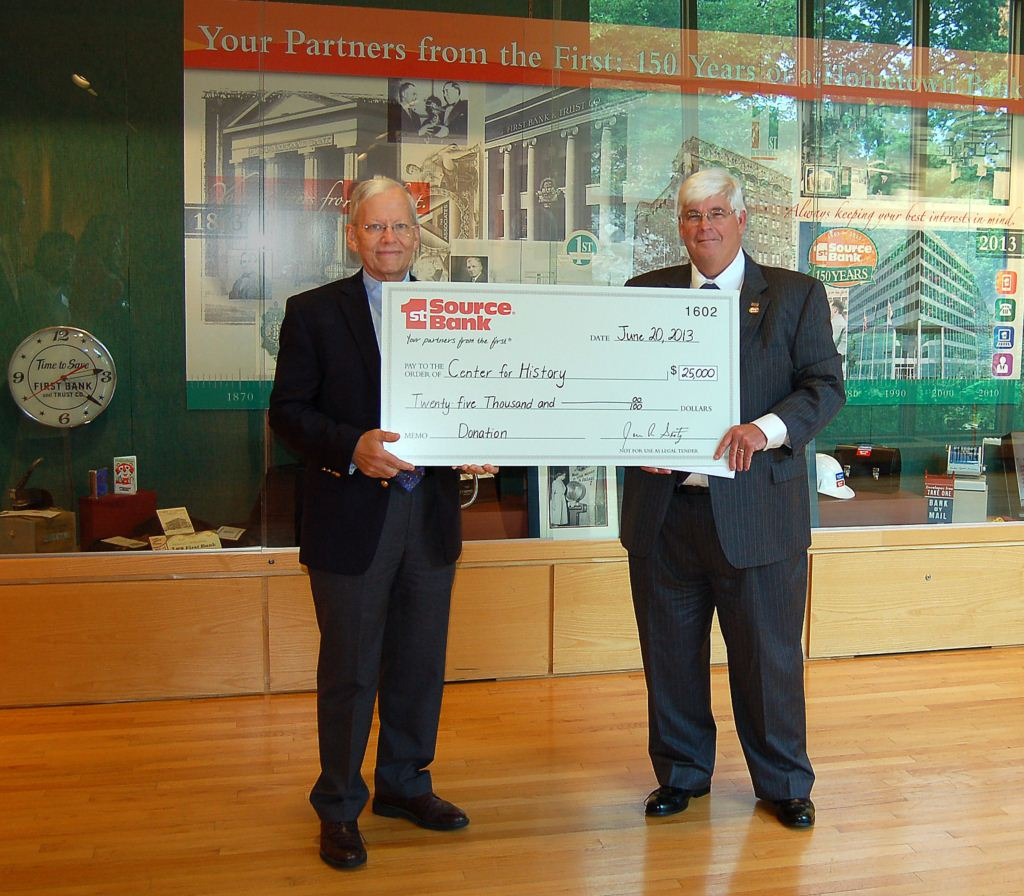 Jim Seitz (right) presenting check to Randy Ray of Center for History