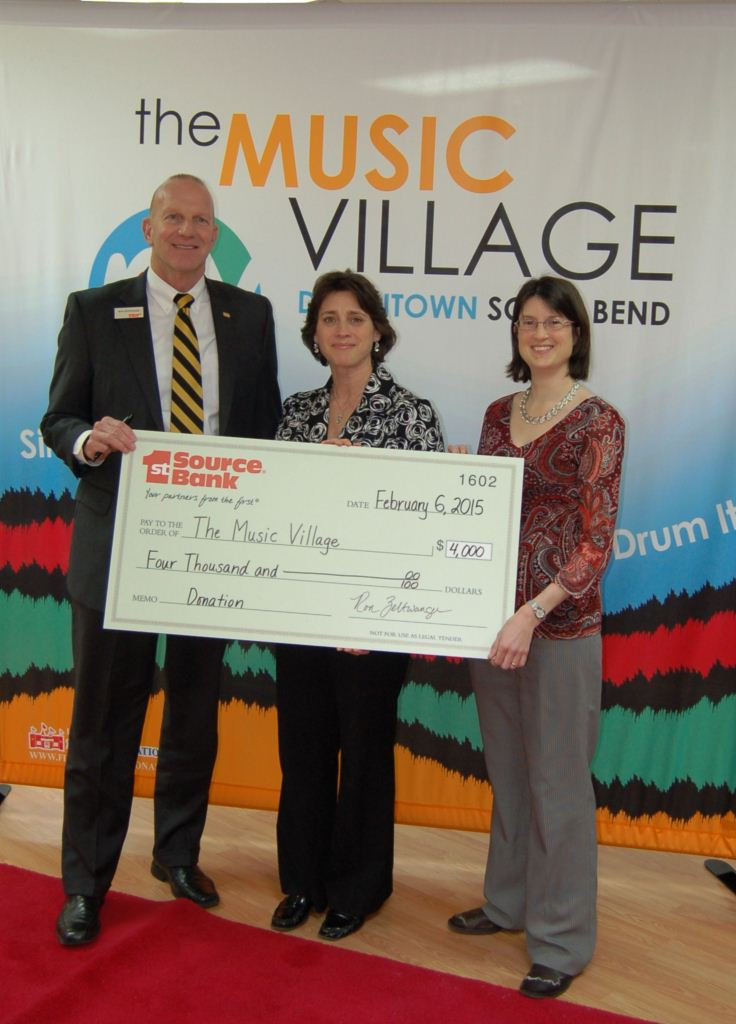 Ron Zeltwanger presents donation to the Music Village